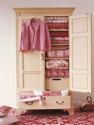 Armoire with quilts