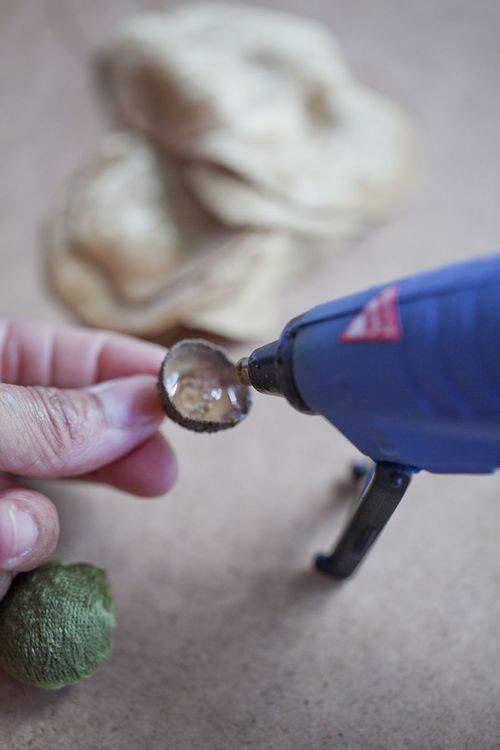 hot glue and acorn caps