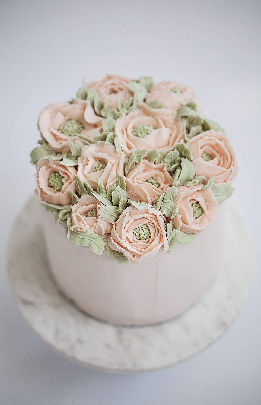 cake with buttercream peonies