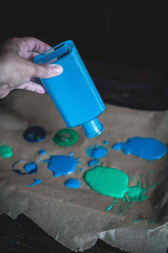 acrylic paint and glass jars