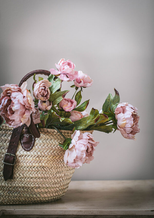 pale pink peonies in a market basket