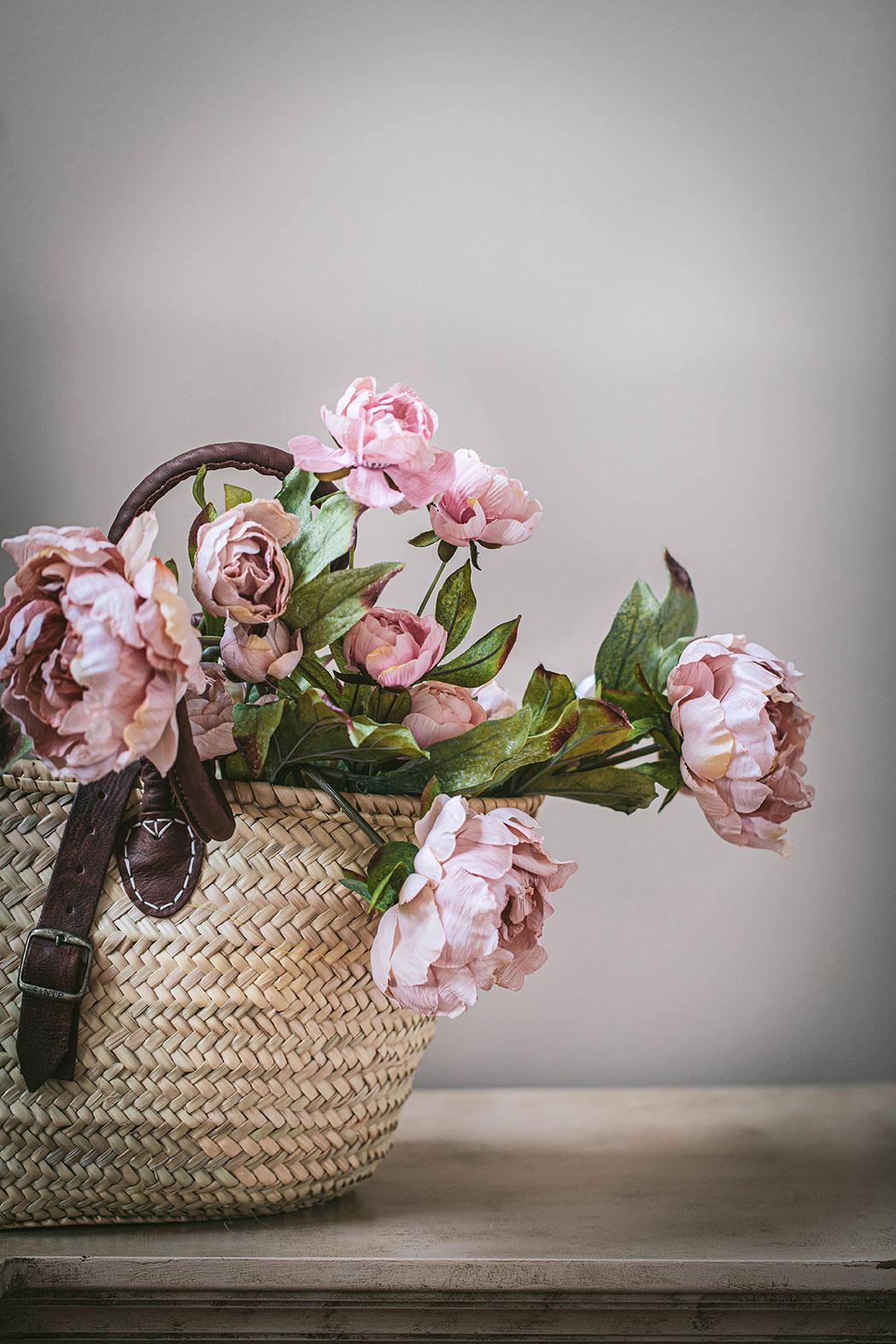 pale pink peonies in a market basket